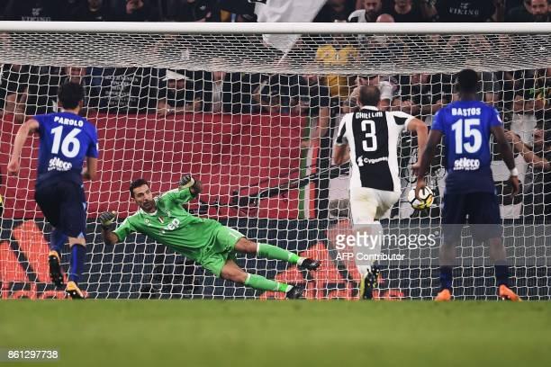 Lazio's forward Ciro Immobile scores against Juventus goalkeeper Gianluigi Buffon during the Italian Serie A football match Juventus Vs Lazio on...