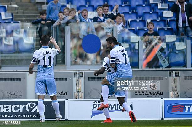 Lazio's forward from Germany Miroslav Klose celebrates after scoring during the Italian Serie A football match Lazio vs Empoli on April 12 2015 at...