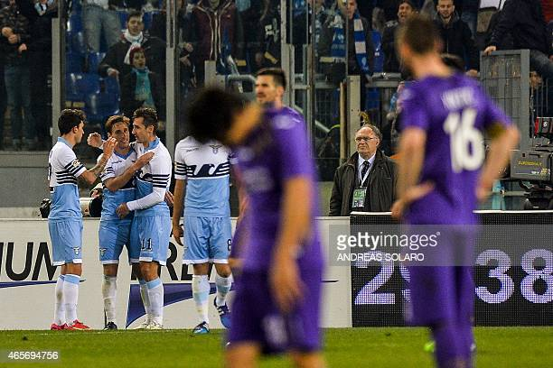 Lazio's forward from Germany Miroslav Klose celebrates with teammates aftrer scoring a goal during the Italian Serie A football match Lazio vs...