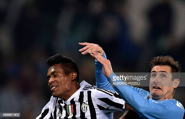 Lazio's forward from Germany Miroslav Klose fights for the ball with Juventus' defender from Brazil Alex Sandro during the Italian Serie A football...