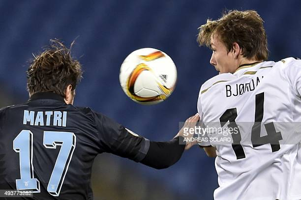 Lazio's forward from Italy Alessandro Matri and Rosenborg's defender from Norway Johan Laedre Bjordal jump for the ball during the UEFA Europa League...