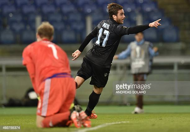 Lazio's forward from Italy Alessandro Matri celebrates after scoring against Rosenborg's goalkeeper from Norway Andre Hansen during the UEFA Europa...