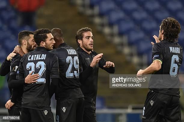 Lazio's forward from Italy Alessandro Matri celebrates with teammates after scoring during the UEFA Europa League football match Lazio vs Rosenborg...