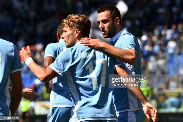 Lazio's forward from Italy Ciro Immobile celebrates with teammates after scoring during the Italian Serie A football match Lazio vs Palermo on April...