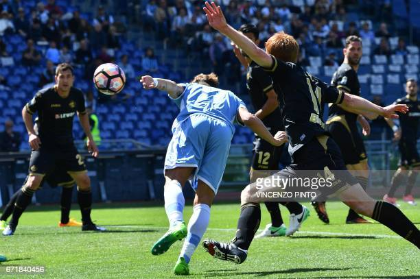 Lazio's forward from Italy Ciro Immobile scores during the Italian Serie A football match Lazio vs Palermo on April 23 2017 at the Olympic stadium in...