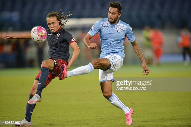 Lazio's forward from Netherlands Ricardo Kishna fights for the ball with Genoa's midfielder from Uruguay Diego Laxalt during the Italian Serie A...