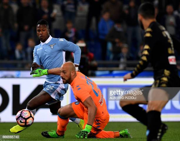 Lazio's forward from Senegal Balde Diao Keita fights for the ball with Napoli's goalkeeper from Spain Pepe Reina during the Italian Serie A football...