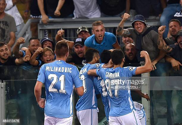 Lazio's forward from Senegal Balde Diao Keita is congratulated by teammates after scoring a goal during the UEFA Champions League playoff football...