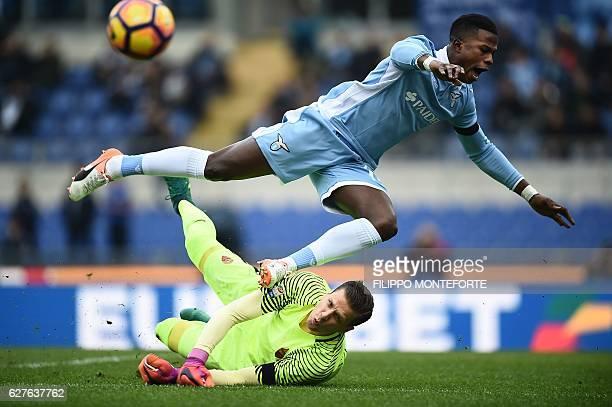 TOPSHOT Lazio's forward from Senegal Balde Diao Keita tries to score against Roma's goalkeeper from Poland Wojciech Szczsny during the Italian Serie...