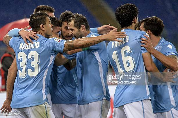 Lazio's forward from Serbia Filip Djordjevic celebrates with his teammates after scoring against Genoa during the Italian Serie A football match...