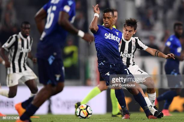 Lazio's forward luis Nani from Portugal fights for the ball with Juventus' forward Paulo Dybala from Argentina during the Italian Serie A football...