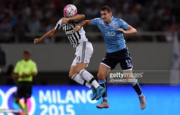 Lazio's forward Miroslav Klose and Juventus defender Leonardo Bonucci vie for the ball during the Italian Super Cup final football match between...
