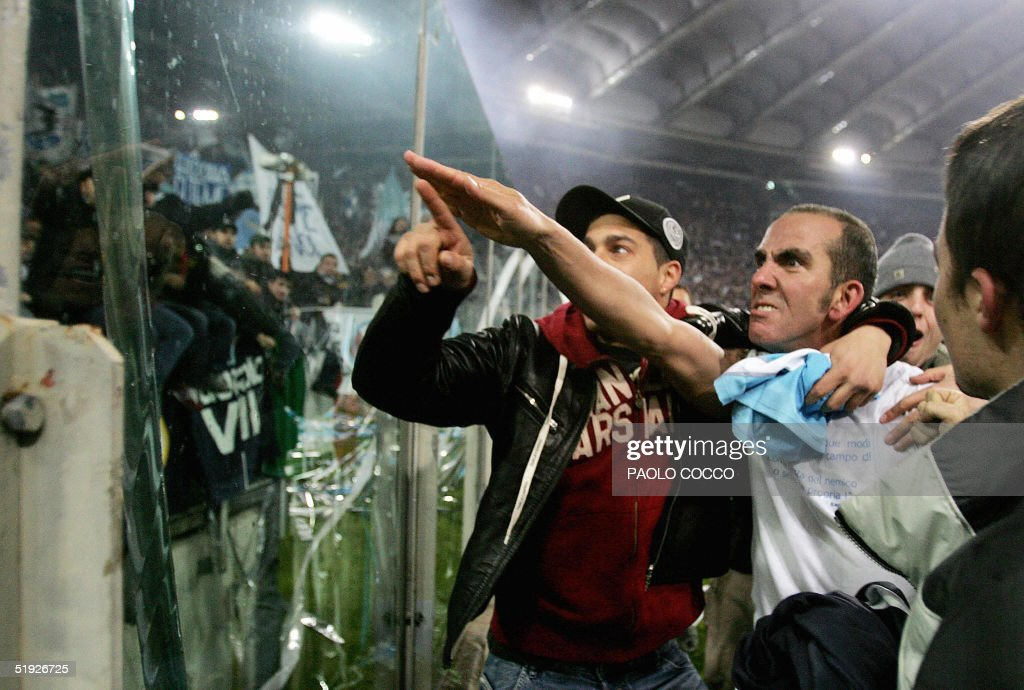 Lazio's forward Paolo Di Canio gestures towards Lazio fans at the end of Lazio vs AS Roma Serie A football match at Rome's Olympic stadium 06 January 2005. Lazio captain Paolo Di Canio is to be investigated by the Italian football federation (FIGC) over an alleged fascist salute during his side's 3-1 victory over bitter city rivals AS Roma. According to witnesses and photographs published in the newspapers Di Canio extended his right arm to the Lazio fans who have a history of racial abuse and suspected fascist leanings. AFP PHOTO/Paolo COCCO