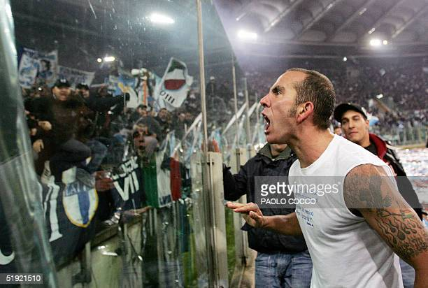 Lazio's forward Paolo Di Canio shouts in celebration with Lazio supporters at the end of Lazio vs AS Roma Serie A football match at Rome's Olympic...