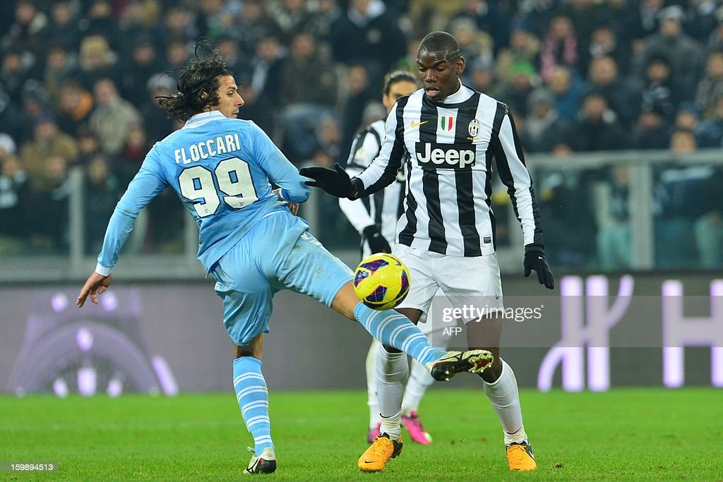 Lazio's forward Sergio Floccari (L) vies with Juventus' French midfielder Paul Pogba during their TIM CUP football match between Juventus and Lazio at the 'Juventus Stadium' in Turin on January 22, 2013.