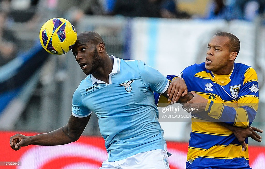 Lazio's French defender Modibo Diakite (L) fights for the ball against Parma's French forward Jonathan Ludovic Biabiany during their Italian Serie A football match on December 2, 2012 at Rome's Olympic stadium. Lazio won 2-1.