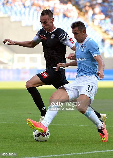 Lazio's German forward Miroslav Klose fights for the ball with Cesena's defender Massimo Volta during the Italian Serie A football match between...