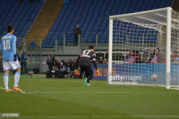 Lazio's German forward Miroslav Klose shoots to score against Atalanta's goalkeeper Marco Sportiello during the Italian Serie A football match...