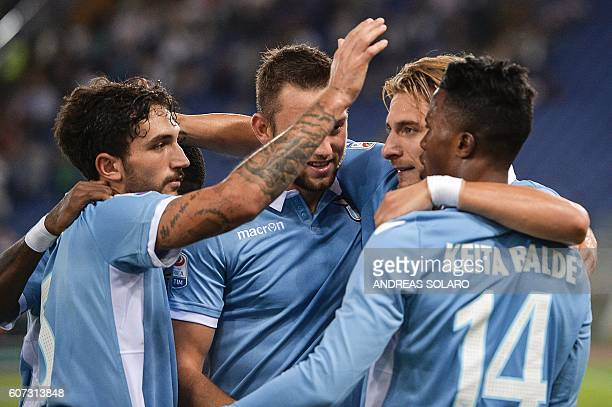 Lazio's Italian midfielder Ciro Immobile celebrates with teammates after scoring a goal during the Italian Serie A football match Lazio vs Pescara on...