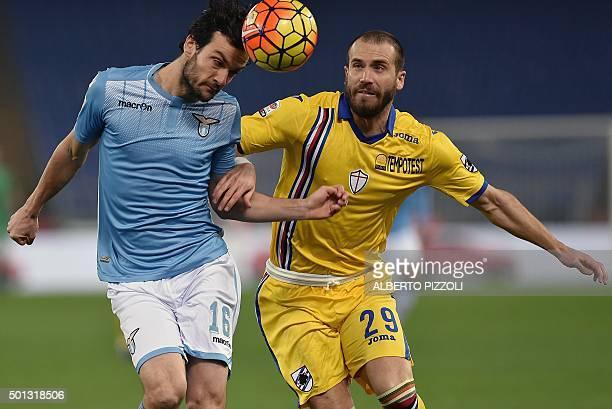 Lazio's Italian midfielder Marco Parolo challenges Sampdoria's Italian defender Lorenzo De Silvestri during the Italian Serie A football match...