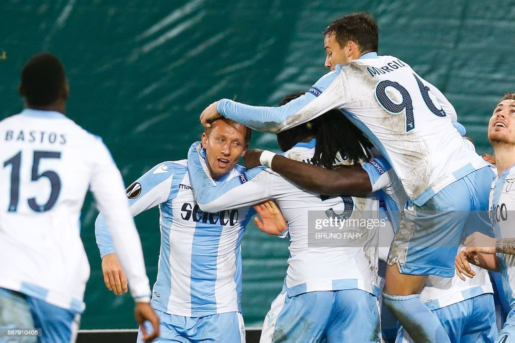 Lazio's Lucas Leiva (C) celebrates with teammates after scoring during the UEFA Europa League Group K football match between SV Zulte Waregem and Lazio at The Regenboogstadion in Waregem on December 7, 2017. / AFP PHOTO / Belga / BRUNO FAHY / Belgium OUT