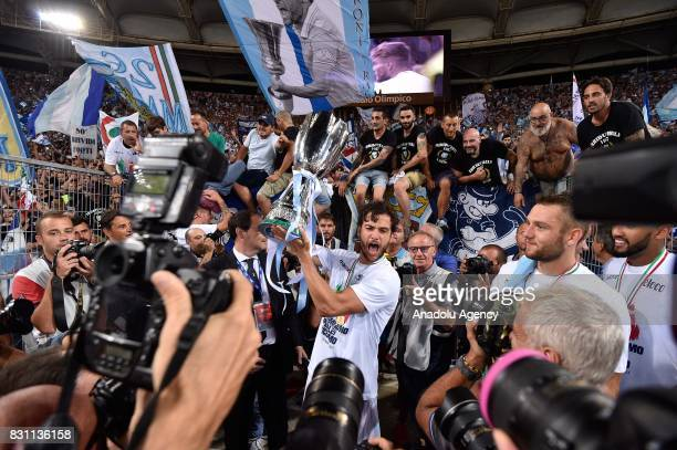 SS Lazio's Marco Parolo celebrates the victory after the Italian Super Cup soccer match between FC Juventus and SS Lazio at Stadio Olimpico on August...