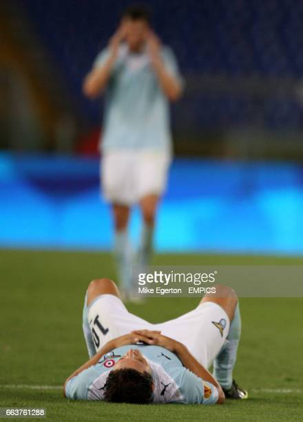 Lazio's Mauro Zarate lies dejected on the grass after FC Salzburg score the winning goal in the last minute
