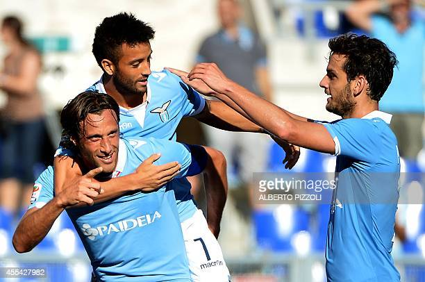 Lazio's midfielder and Captain Stefano Mauri celebrates after scoring during the Italian Serie A football match between Lazio vs Cesena on September...