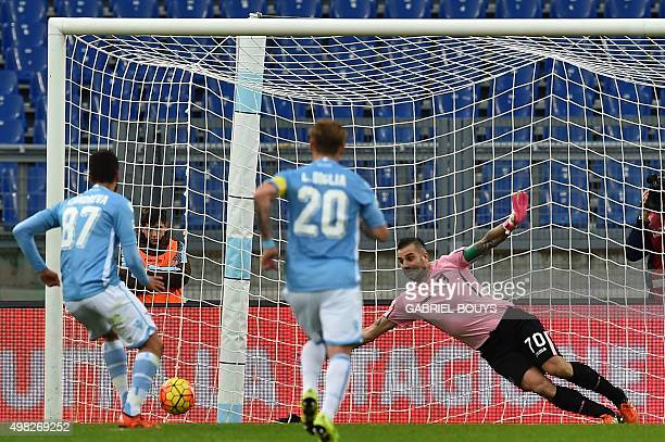 Lazio's midfielder Antonio Candreva from Italy scores a penalty against Palermo's goalkeeper Stefano Sorrentino from Italy during the Italian Serie A...