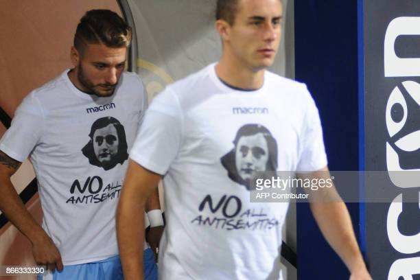 Lazio's midfielder Ciro Immobile and teammates wear tshirts against antisemitism showing an image of holocaust victim Anne Frank during the warm up...