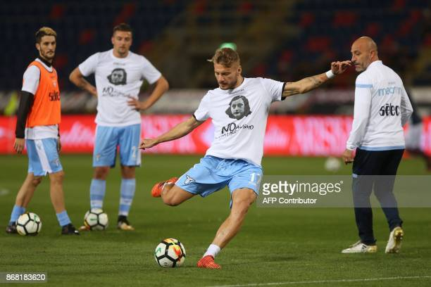 Lazio's midfielder Ciro Immobile wears a tshirt against antisemitism showing an image of holocaust victim Anne Frank during the warm up prior the...