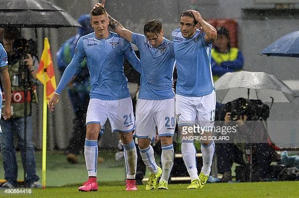 Lazio's midfielder from Argentina Lucas Biglia celebrates with teammates Lazio's forward from Italy Alessandro Matri and Lazio's midfielder from...