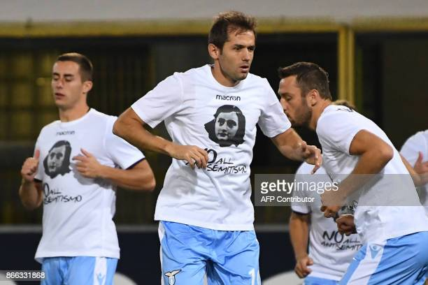 Lazio's midfielder from BosniaHerzegovina Senad Lulic and teammates wear tshirts against antisemitism showing an image of holocaust victim Anne Frank...