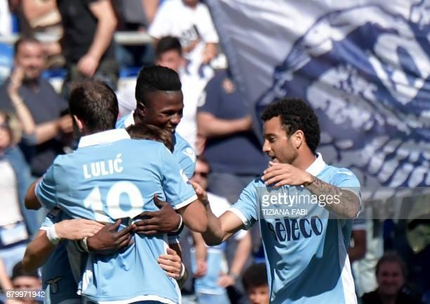 Lazio's midfielder from BosniaHerzegovina Senad Lulic celebrates with teammates after scoring during the Italian Serie A football match Lazio vs...