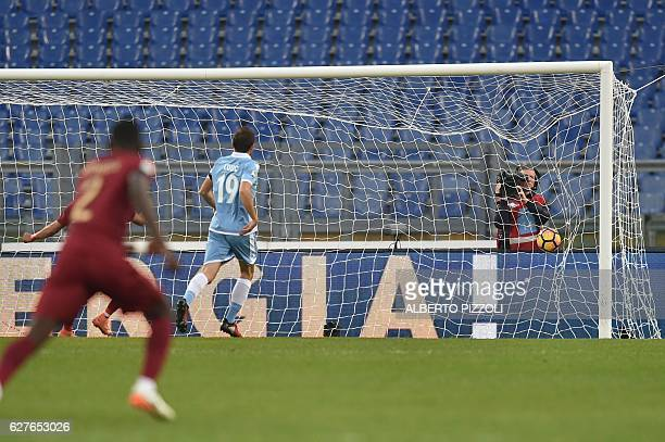 Lazio's midfielder from BosniaHerzegovina Senad Lulic looks at the ball in the net after a goal by Roma's midfielder from Netherlands Kevin Strootman...