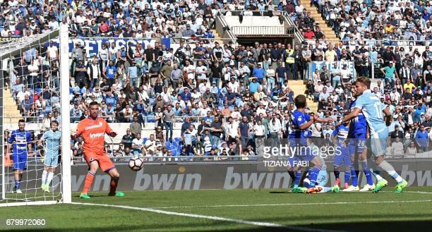 Lazio's midfielder from BosniaHerzegovina Senad Lulic scores during the Italian Serie A football match Lazio vs Sampdoria at the Olympic Stadium in...