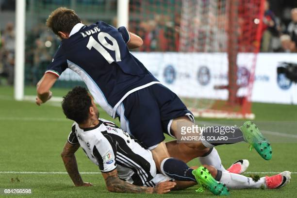 Lazio's midfielder from BosniaHerzegovina Senad Lulic vies with Juventus Defender from Brazil Dani Alves during the Italian Tim Cup final on May 17...