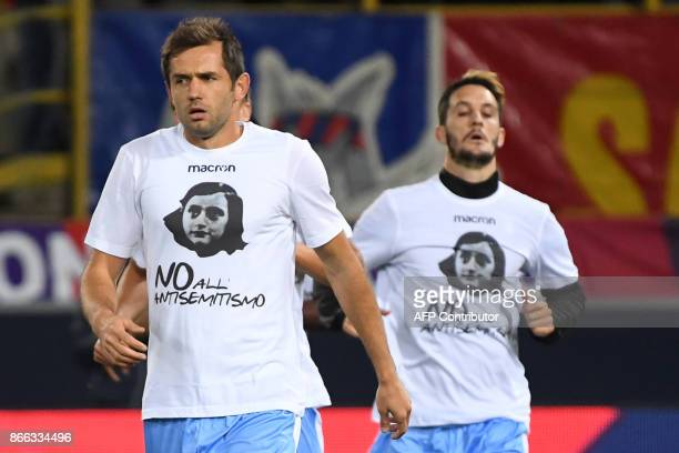 Lazio's midfielder from BosniaHerzegovina Senad Lulic wears a tshirt showing an image of holocaust victim Anne Frank during the warm up prior the...
