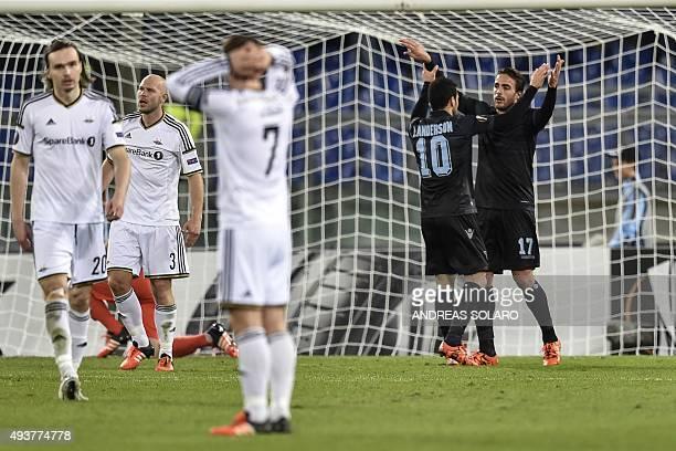 Lazio's midfielder from Brazil Felipe Anderson celebrates with his teammate Matri after scoring during UEFA Europa League football match Lazio vs...