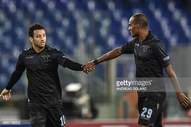 Lazio's midfielder from Brazil Felipe Anderson celebrates with his team mate Lazio's defender from France Abdoulay Konko after scoring during UEFA...