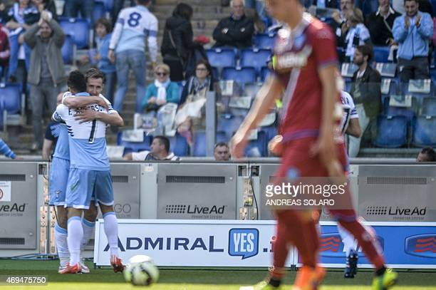 Lazio's midfielder from Brazil Felipe Anderson celebrates with Lazio's forward from Germany Miroslav Klose after scoring during the Italian Serie A...