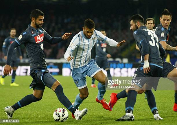 Lazio's midfielder from Brazil Felipe Anderson fights for the ball with Napoli's defender from Uruguay Miguel Angel Britos and Napoli's defender from...