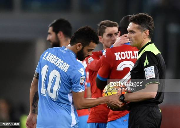 Lazio's midfielder from Brazil Felipe Anderson looks at the watch of referee Massimiliano Irrati after he suspends the game due to racist chants by...