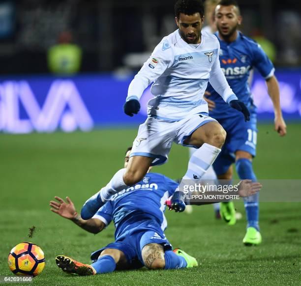 Lazio's midfielder from Brazil Felipe Anderson vies with Empoli's midfielder from Italy Riccardo Saponara during the italian Serie A football match...