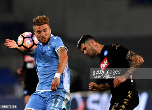 Lazio's midfielder from Italy Ciro Immobile fights for the ball with Napoli's defender from Albania Elseid Hysaj during the Italian Serie A football...