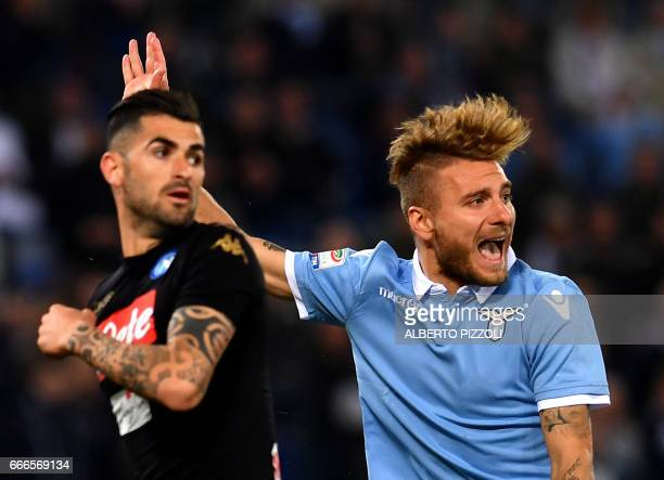 Lazio's midfielder from Italy Ciro Immobile reacts next Napoli's defender from Albania Elseid Hysaj during the Italian Serie A football match Lazio...