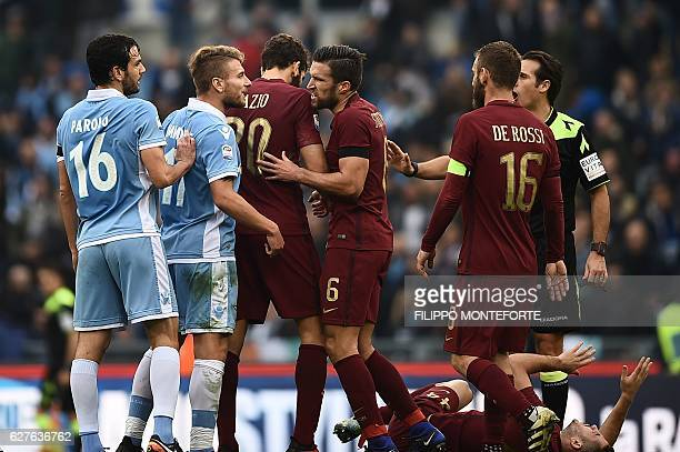Lazio's midfielder from Italy Marco Parolo and Lazio's forward from Italy Ciro Immobile argue with Roma's defender from Argentina Federico Fazio...