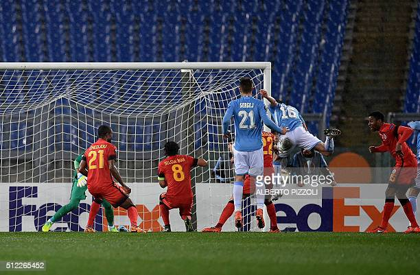 Lazio's midfielder from Italy Marco Parolo jump and scores during the UEFA Europa League football match Lazio vs Galatasaray on February 25 2016 at...