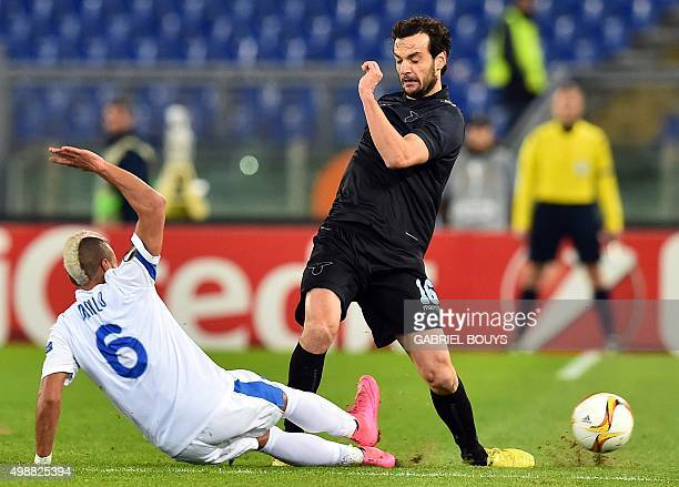 Lazio's midfielder from Italy Marco Parolo vies with Dnipropetrovsk's midfielder from Brazil Danilo during the UEFA Europa League football match...