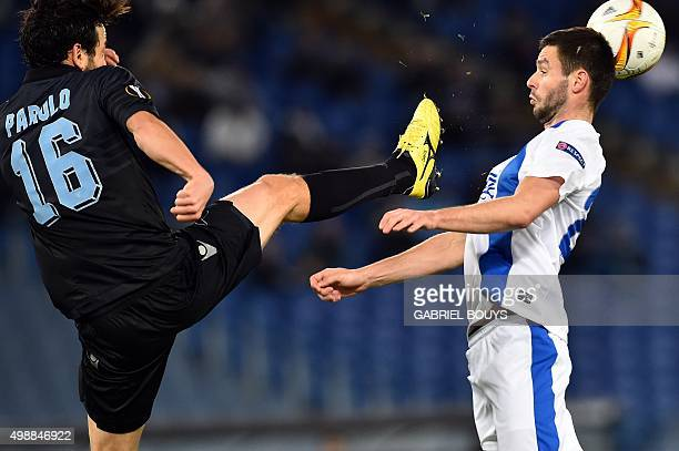 Lazio's midfielder from Italy Marco Parolo vies with Dnipropetrovsk's midfielder from Ukraine Yevhen Shakhov during the UEFA Europa League football...